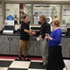 Alex Arpero shakes hands with Principal Craig Stauffer and Debbe Jones after receiving the keys and car title to a '97 Pontiac Sunfire. Arpero received the car as part of Jones' No Dreams Deferred scholarship foundation. —Eric Bailey
