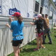 Teens install new siding on the Blevins home in West Grove as part of the Good Neighbors Youth Camp