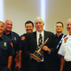 Caption07_Holladay Fire Chief Marty Slack and crew present award to Fitts. —Carol Hendrycks