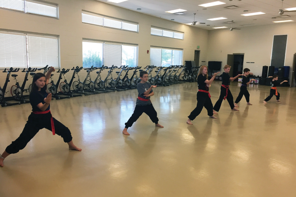 "Jik kiu, meaning ""direct bridge,"" is a critical kung fu move. Here, students practice a series of jik kiu strikes to warm up for practice."