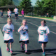 Three Summit Academy students run during the school's 10th annual Jogapooloza that helped bring funds for new playground upgrades and technology to their school. — Julie Slama