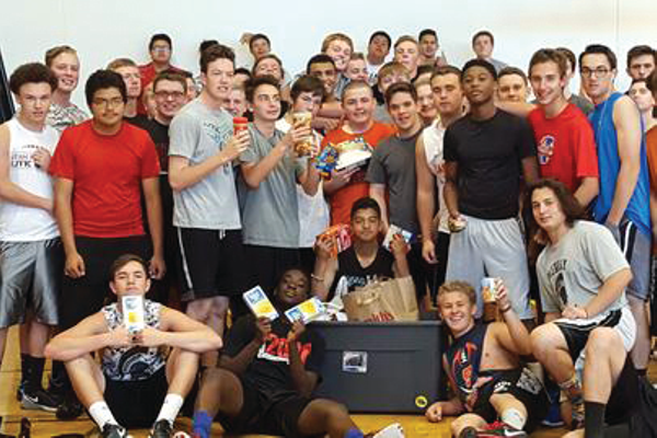 Members of the Murray High boys athletic class pose for a photo at the end of their food drive in June. A competition was held between the boys and girls athletic classes to see who could raise the most food for the KidsEat! organization. – Lynda Brown