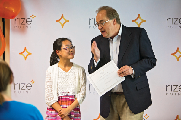 Sunrise Elementary's Marianne Liu recently was awarded a RizePoint scholarship by CEO Frank Maylett to attend a video game design camp this summer. — Mindi Hamilton