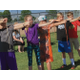 Children practice archery techniques using a string bow. – Tori La Rue