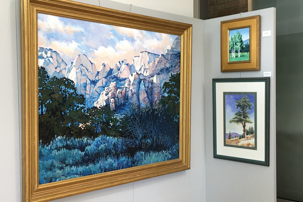 Ron Larson's paintings hang in the George S. & Dolores Dore Eccles Gallery at Salt Lake Community College's South City Campus. Larson, now a professional artist, grew up in Taylorsville and attended SLCC. –Tori La Rue