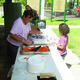Georgia Martin serves food to a child at Fitts Park on July 22 as part of Granite School District's Seamless Summer Program. –Travis Barton