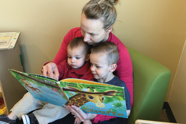 Michelle Misener reads to her sons Geyson, 3, and Logan, 1, at the South Jordan Library. –Tori La Rue