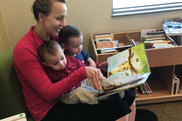 Greyson, 3, and Logan, 1, read with their mother, Michelle Misener, at the South Jordan Library. –Tori La Rue