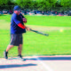 A firefighter hits the softball at the annual Guns vs. Hoses event during Taylorsville Days. --Unified Fire Authority