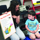 Jennifer Adams, preschool teacher, asks Brody Drope, 4, to point to specific letters on a giant poem book. –Tori La Rue