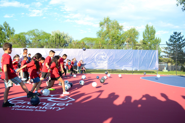 Granger Elementary students kick soccer balls toward a goal to officially open the RSL donated soccer pitch. –Kimberly Roach