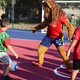Leo the Lion participates in a scrimmage with Granger Elementary students after the opening ceremonies of the new soccer pitch. –Kimberly Roach