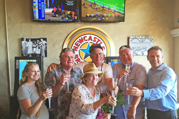 "the owners and the trainer toast with champagne in the the ""Winner's Bar"""
