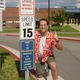 Jim Olsen poses for a picture by a sign he hung up at Taylorsville High School, denoting the school as croquet state champions for the 1985 and 1986 school years. –Jim Olsen