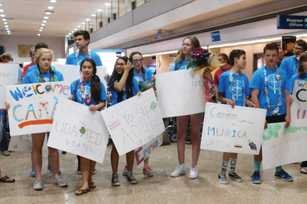 Americans teens hold up posters to welcome teens from Northern Ireland into Utah for the Utah Ulster Project. The Ulster Project is a peace project designed to bring Protestant and Catholic teens together despite their differences.  -- Utah Ulster Project