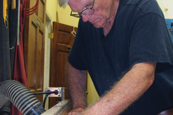 Bill Hughes works in his woodshop making flutes out of wood. –Travis Barton