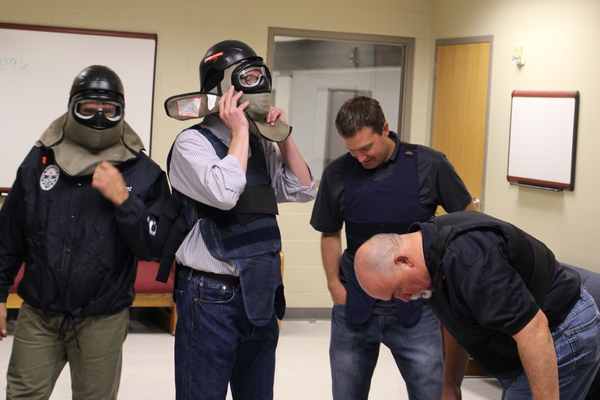 "L to R: Sandy Councilman Chris McCandless, District 4, Councilman Stephen Smith, at-large, City Council Office Director Mike Applegarth and Councilman Steve Fairbanks, at-large, don protective vests and helmets for using Simunition, a simulation ammo and gun, on each other for ""isolation drills"" on Aug. 23, 2016 at the Salt Lake Community College - Miller Campus.  (My City Journals/Chris Larson)"
