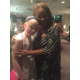 Ella receives a warm hug from award-winning star Denise Lee after the first act.