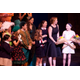 Ella is greeted by Erica Peterman, and her friends and cast-mates on stage.