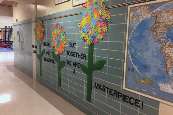 Handprints from students celebrate the school family. (Sarah Madsen/Howard Driggs Elementary)