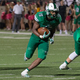 Audricke Gaines (15) runs for one of his 3 TDs as the Dragons defeated rival Euless Trinity by a score of 42-28 at Dragon Stadium on September 30, 2016. Photo by SnappedDragons.com/S. Johnson.