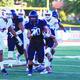 Senior team captain Joshua Davis running against Timpview earlier this season. (Alta High School Football)
