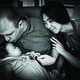 Zariah is held by her parents, Shawn and Vilayvone. (Matt Stone - Four Cameras Photography)