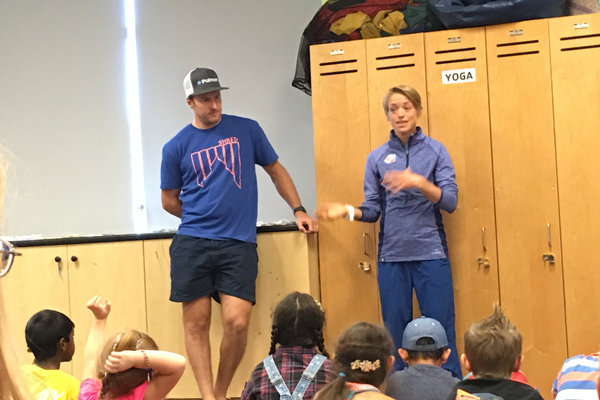 Ted Ligety and Liz Stephen, Olympic skiers, answer questions from child spectators after a motivational presentation at the YMCA Community Family Center in Taylorsville. (Tori La Rue/City Journals)