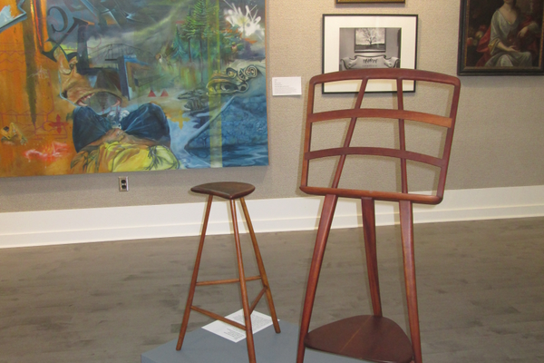 A music stand and stool by Wharton Esherick stand near a large 2003 painting by graffiti artist Julian Correia.