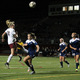 Sophomore Meredith Haakenson with a header toward the Rebel goal. (photo by Doug Erlien)