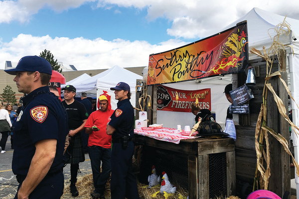 "Unified Fire Authority named their Utah Firefighter Chili Cook-Off booth the ""Sultry Poultry"" because they made their chili with chicken. (Tori La Rue/City Journals)"