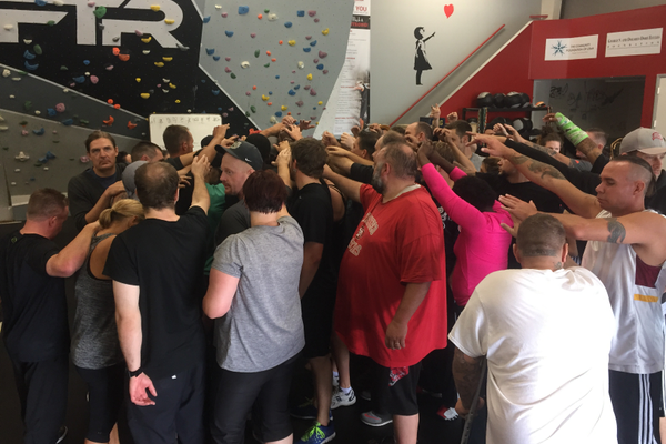 "Every Saturday morning bootcamp is closed out with a traditional group breakdown and inspirational words from founder Ian Acker. ""What makes FTR so unique is the amazing group of people we have here,"" Acker said. ""They give others hope."" (City Journals)"
