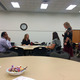 Community Engagement Coordinator Susan Edwards guides parents through school community council training. (Rubina Halwani/City Journals)
