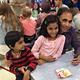 Fathers and kids enjoy the Watch DOGS kick-off event, Pizza Night. (Rubina Halawani/City Journals)