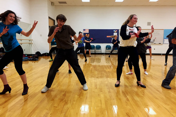 "Juan Diego Catholic High School students rehearse for ""Grease,"" which will open Nov. 10 on the school stage. (Joe Crnich/Juan Diego Catholic High School)"