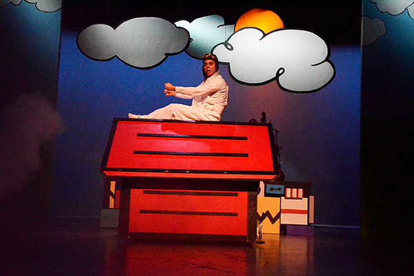 Snoopy, played by Wade Flanagan, imagines himself as an ace fighter pilot fighting the Red Baron.  (Karla Marsden/Sandy Arts Guild)
