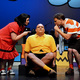 Lucy, played by Krista Gowda, and Linus, played by Drew Thompson, examine the sad face of Charlie Brown, played by Josh Little. (Karla Marsden/Sandy Arts Guild)