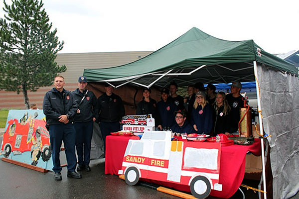 Representatives from the Sandy City Fire Department pose for a picture at the Fourth Annual Utah Firefighter Chili Cook-off. (Keri Jones/UDK)