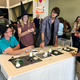 """Members of the Westminster College chapter of the American Chemical Society help a child create a """"potion"""" during the Viridian Event Center's Roald Dahl Day celebration on Oct. 7. (Tori La Rue/City Journals)"""
