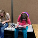 Cheyenne Sawatis and Nora Fred team up to program their robot. (Jet Burnham/City Journals)