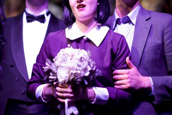 Brynnly Bosworth holds flowers as Tyler Mitchell (right) and Jordan Dixon (left) as they all sing during one of the final musical numbers. The cast fought through the flu during its final few weeks of show preparation and overcame a faulty mic to open the show on Oct. 13. (Dustin Bolt and Amy Bosworth/Midvale Main Street Theatre)