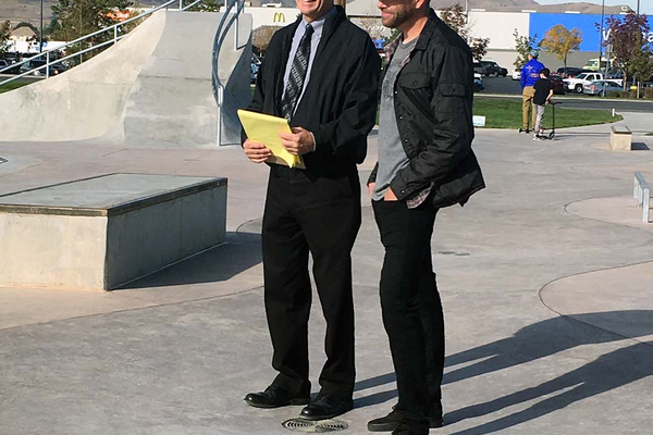 Skate park 01: Kevin Astill, West Valley City parks and recreation director, laughs next to community advocate Josh Scheuerman during the ribbon cutting ceremony for a new skate park at Centennial Park on Saturday, Oct. 8. (Travis Barton/City Journals)