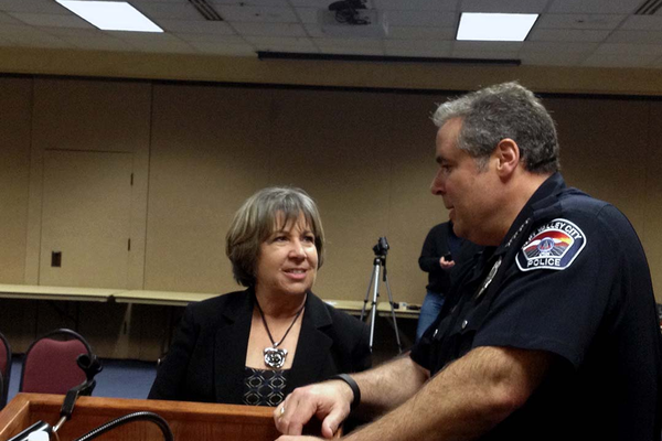 Chief Lee Russo speaks with Donna Kelley of the Utah Prosecution Council in April at West Valley City Hall. (Travis Barton/City Journals)