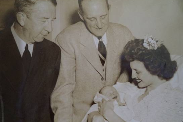 Herb and Ed Collins Sr. with Jane Pennock and baby Eddie Collins III upon his birth.