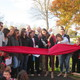 Michelle OKane a former fourth-grade teacher at Hillendale cuts the ribbon to officially open the new trail at Hillendale