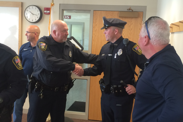 New Dracut Police officer Kyle Donahue is congratulated.