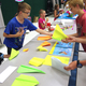 """Fourth-grader Logan Wilson learned how to make different kinds of paper airplanes and then established his business, """"Awesome Airplane Acts"""" as part of South Jordan Elementary's Economics Fair. — Julie Slama"""