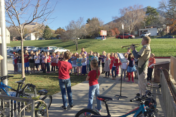 Third-graders hoist the flag for a Veterans Day ceremony. (Upland Elementary)