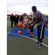 Utah Jazz assistant coach DeSagana Diop works on passing with Junior Jazz youth players at the grand re-opening of Bingham Junction Park on Oct. 27. Travis Barton/City Journals)