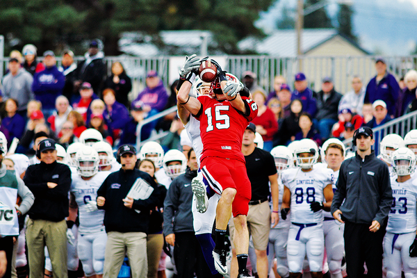 Andy Harris intercepts the ball against nationally ranked Linfield College (Ore.) on Oct. 8. Harris was named to the academic all-district team. (Tanner Boyle/Pacific University)